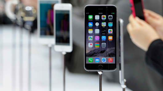 An Apple iPhone 6 is displayed after a product announcement at Flint Center in Cupertino, Calif., on Tuesday, Sept. 9, 2014.