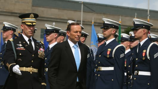 Prime Minister Tony Abbott of Australia inspects the troops during a Honor Cordon at the Pentagon in Arlington, Virginia, during a U.S. state visit in June.
