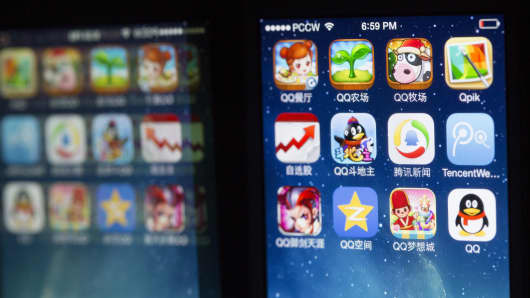 Tencent Holdings Ltd. application icons are displayed on an Apple Inc.