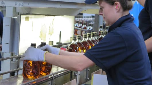 An employee works the production line at the Ian Macleod distillery in Scotland.