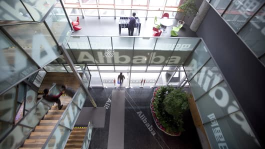 People walk through Alibaba headquarters in Hangzhou, Zhejiang Province, China.
