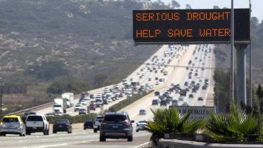 A digital traffic sign informs travelers southbound on Interstate Highway 5 to conserve water, as they pass through Del Mar, Calif.