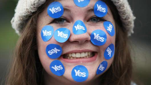 A women wears stickers on her face in Edinburgh, Scotland September 18, 2014.
