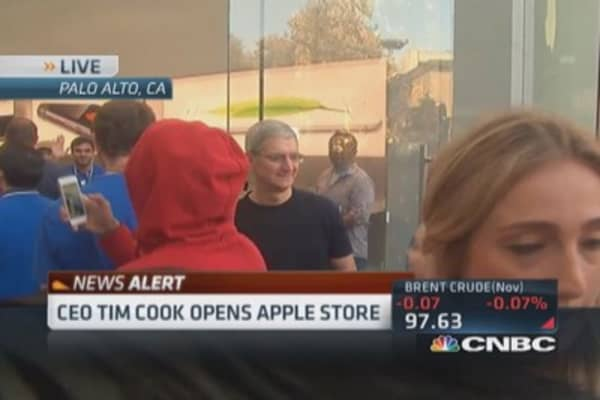 CEO Tim Cook tours Apple store