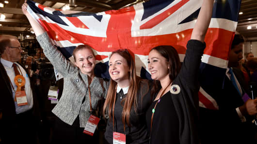 Pro-union supporters celebrate as the Scottish independence referendum polling results are announced in Edinburgh, Scotland, Sept. 19, 2014.