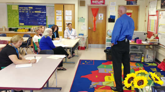 Allen Cox, managing director of the Maryland Council on Economic Education, teaches elementary school teachers how to teach financial literacy at the Cromwell Valley Elementary School in Towson, Md.