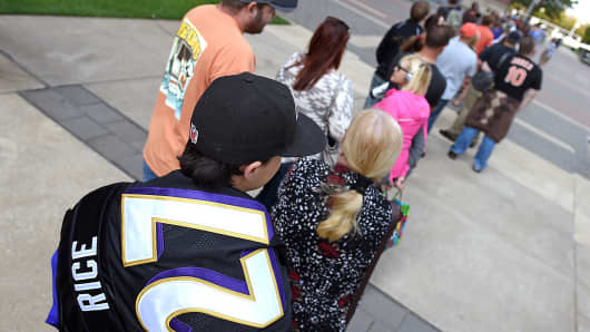 Baltimore Ravens fans stand in line to exchange their Ray Rice jerseys for different ones at M&T Bank Stadium in Baltimore, Sept. 19, 2014.