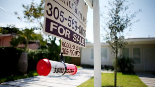 A for sale sign is shown in front of a home in Miami.