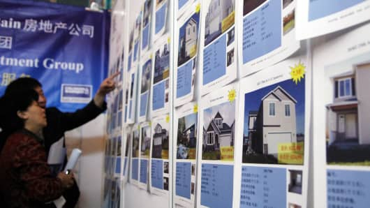 Houses for sale at a real estate summit & trade fair in Beijing, China.