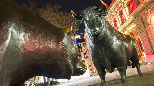 Bear and bull statues are pictured in front of the Frankfurt Stock Exchange in Frankfurt, Germany.