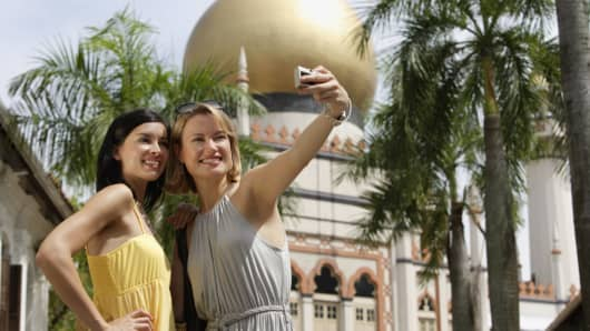 Tourists taking a picture before the Sultan Mosque in Singapore.