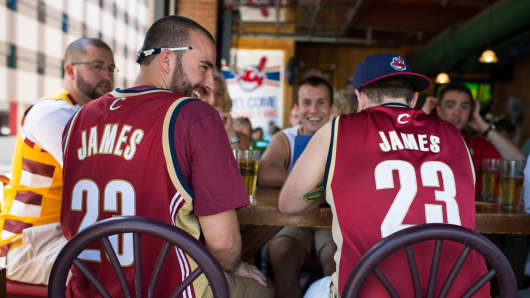 Fans wearing LeBron James shirts gather at a bar in downtown Cleveland on July 11, 2014.