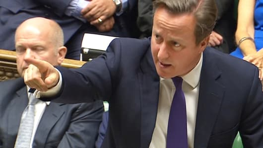 A still image taken from video shows Britain's Prime Minister David Cameron addressing the House of Commons in central London September 26, 2014.