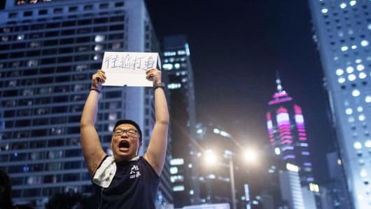 A protester instructs people to move to Chater Road in the Central District on September 29, 2014 in Hong Kong.