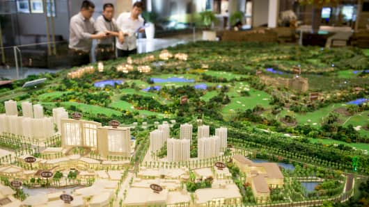 A scale model of the Mission Hills Lan Kwai Fong development and residential properties stands on display in a showroom at Mission Hills Resort Haikou in Haikou, Hainan Province, China.