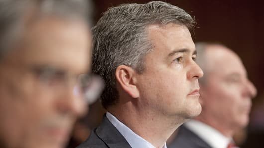 In this June 14, 2011 photo, Daniel Gallagher, nominee for Commissioner of the Securities and Exchange Commission, listens during a Senate Banking Committee hearing on Capitol Hill in Washington.