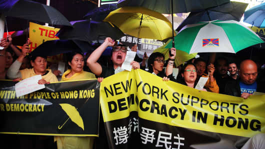 People demonstrate in New York's Times Square on October 1.