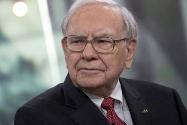 Buffett buying stocks and businesses
