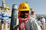 Oil workers at an oil facility near Riyadh, Saudi Arabia.