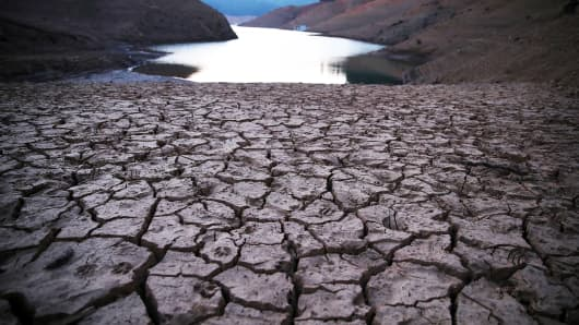 Dry cracked earth is visible on the banks of Shasta Lake at Bailey Cove in Lakehead, Calif.