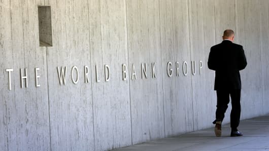 An employee walks outside the World Bank headquarters in Washington, United States.