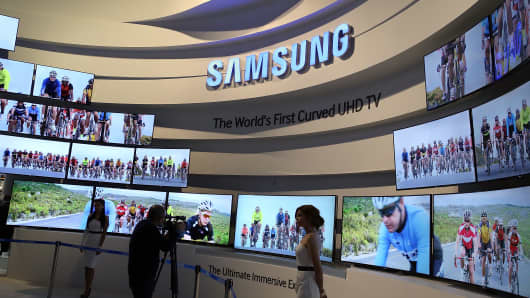 Curved UHD televisions are displayed at the Samsung booth at the 2014 International CES in Las Vegas, Nevada.