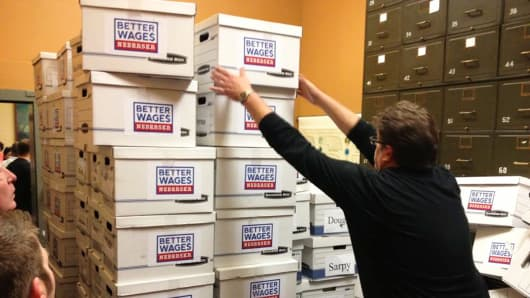 Neal Erickson, Deputy Secretary of State for elections, handles boxes containing petitions that helped to get a proposed Nebraska wage hike measure on the November ballot.