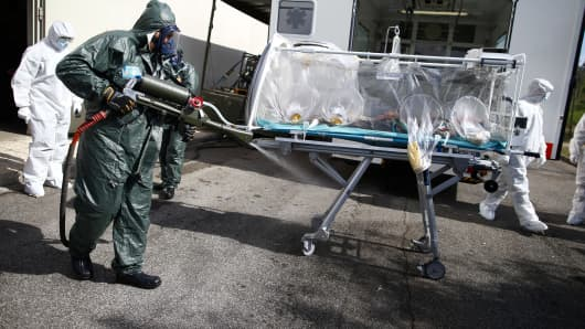 Italian Air Force soldiers attend a military exercise preparing to help people infected with the Ebola virus at the Pratica di Mare Air Base, near Rome, on September 24, 2014.