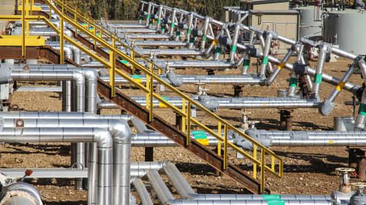 Cenovus wellpad, oils sands facility sign, oil field, oil pipeline
