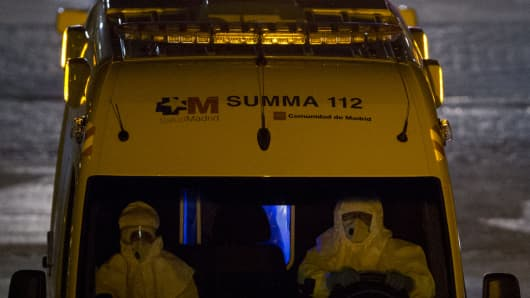 The Spanish nurse infected by Ebola is moved by ambulance to Carlos III Hospital from Alcorcon Hospital on October 8, 2014 in Alcorcon, Spain.