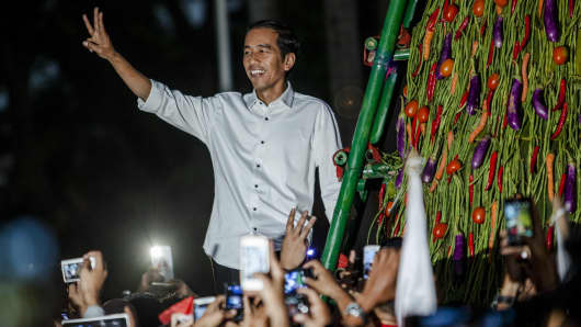 Elected Indonesian President Joko Widodo waves to supporters.