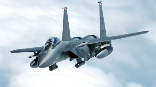 An F-15E Strike Eagle, based at Royal Air Force Lakenheath, United Kingdom, banks away after receiving fuel during a training mission.