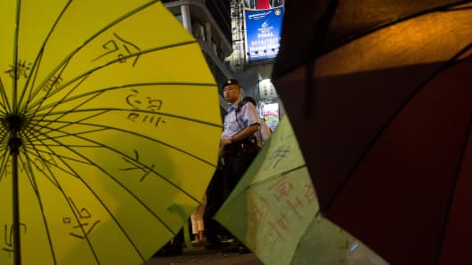 A police officer stands in front of the protest site in Mongkok area on October 6, 2014 in Hong Kong