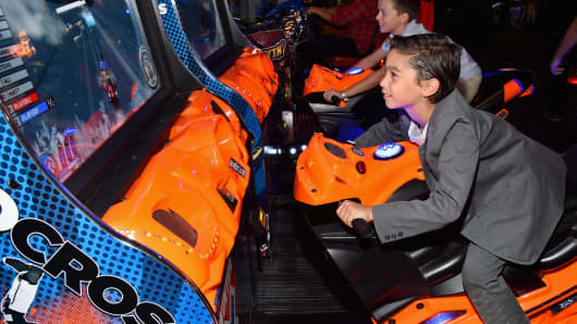 Guests play at Dave & Busters