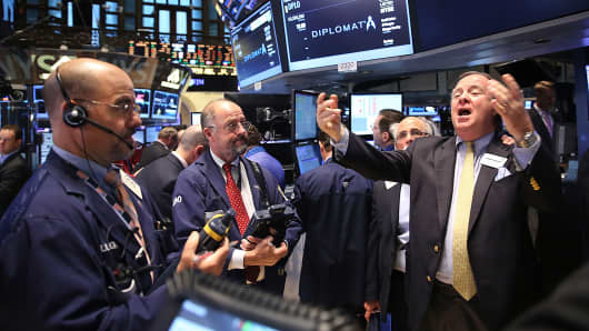 Traders work on the floor of the New York Stock Exchange, Oct. 10, 2014.
