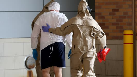 A possible Ebola patient is brought to the Texas Health Presbyterian Hospital on October 8, 2014 in Dallas, Texas.