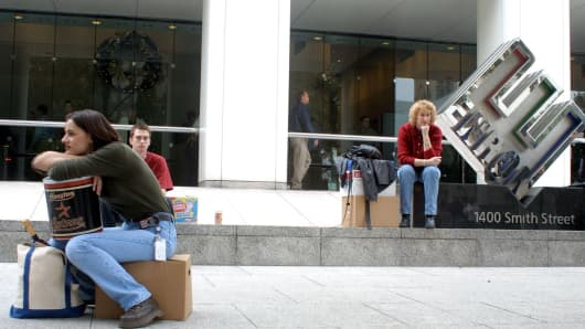 File photo: Laid-off Enron employees outside Enron headquarters as the company collapsed in 2001