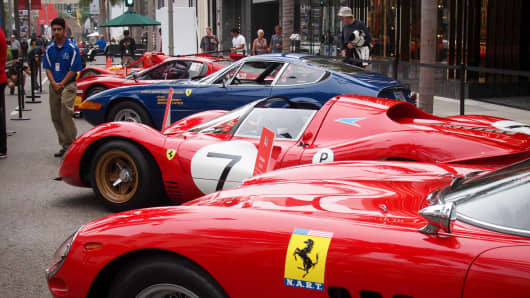 Ferrari's line Rodeo Drive in Beverly Hills, Calif., to celebrate it's 60th year anniversary in North America.