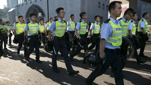 Police march to the streets to control the situation with protesters as barricades were moved in an attempt bring order back to the streets in Hong Kong.