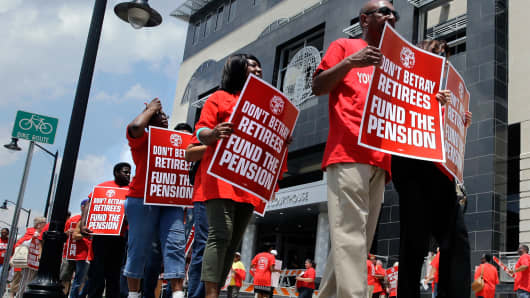 Union members protest New Jersey Gov. Chris Christie's plan to use pension payments to balance the budget in June of last year.