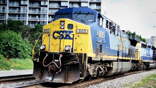 CSX 2Q profit down 20 percent as rail volume slows 9 percent