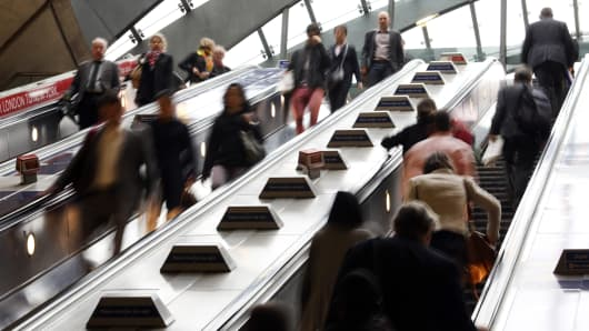 Commuters at Canary Wharf underground tube station