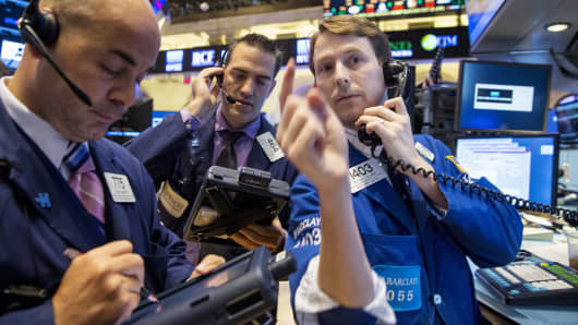 Traders work on the floor of the New York Stock Exchange, Oct. 15, 2014.