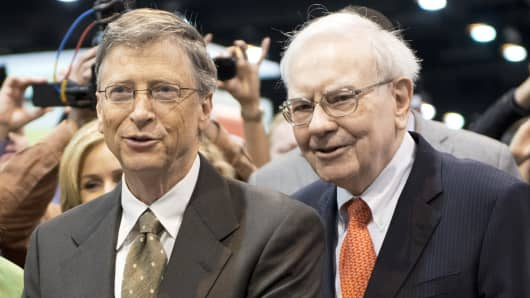 Microsoft co-founder and Berkshire Hathaway board member Bill Gates, left, and Chairman and CEO Warren Buffett are shown prior to the annual shareholders meeting in Omaha, Neb.