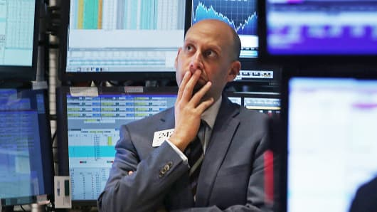 A trader works on the floor of the New York Stock Exchange, Oct. 15, 2014.