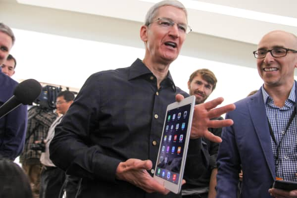 Tim Cook holds up the new iPad Air 2 at an Apple event on Oct. 16, 2014.
