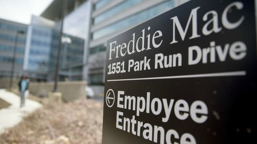 An employee entrance sign stands outside Freddie Mac headquarters in McLean, Va.
