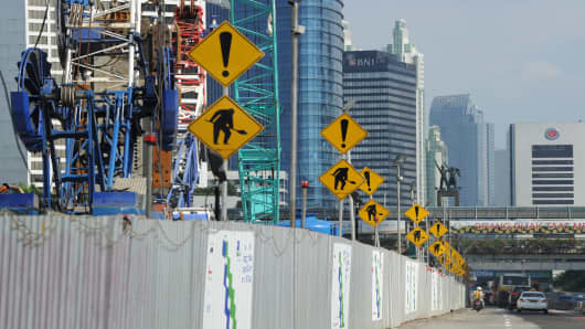 Construction warning signs are posted on the construction site of Indonesia's mass rapid transit in Jakarta on August 5, 2014.