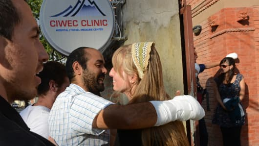 Snowstorm survivors, treated for frostbite, after their discharge from a hospital in Kathmandu on October 18.