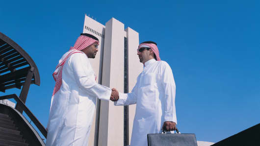 Saudi businessmen in front of the NCB building in Jedda, Saudi Arabia